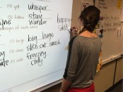 Tiana Stauffer writes on a whiteboard