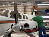 Aviation student works on an airplane