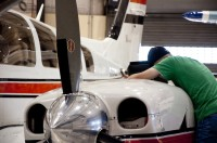 Aviation student works on engine