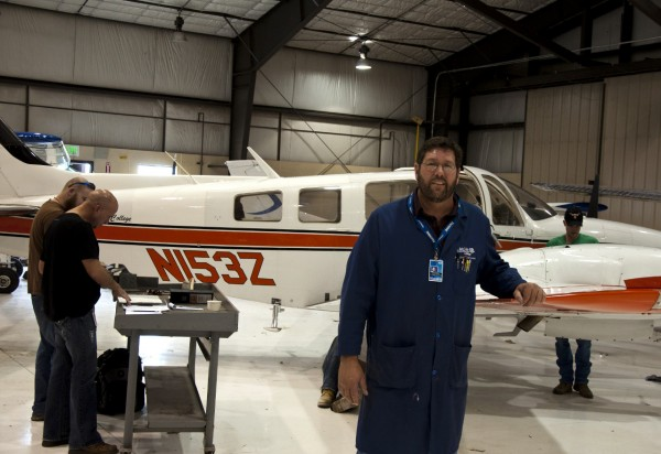 Todd Baird in the hangar with aviation students