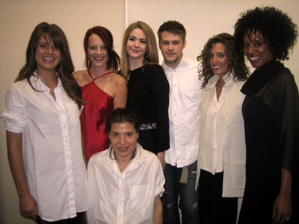 Sylvia Heisel (seated) surrounded by SLCC fashion students and faculty