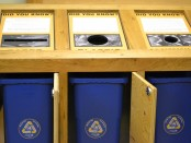 Open doors showing recycling containers