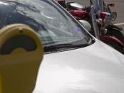 Student car at a parking meter