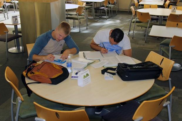 Elijah Amodt, left, and Robert Liessman do homework