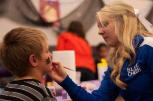 Brittani Nokes paints a child's face