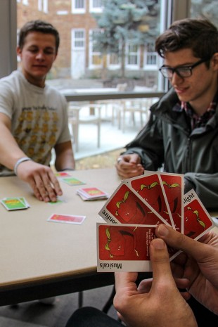 SLCC students play a card game