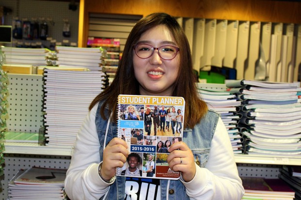 April Kim with a student planner