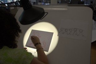 Alexa Kruckenberg practice character animation at one of the several light tables in the Animation/Gaming Lab