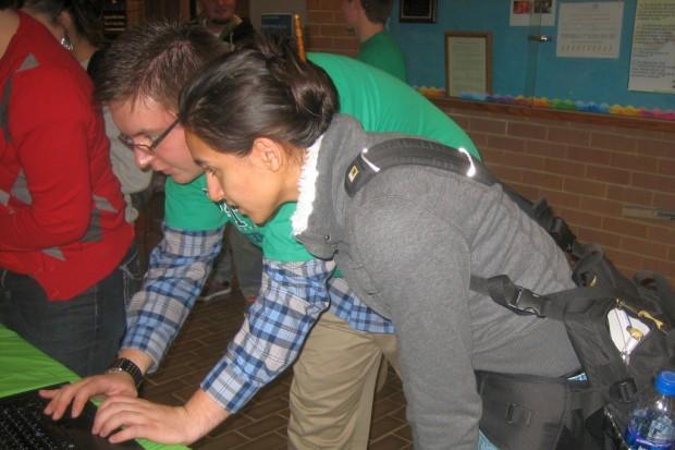 Zach Case, left, helps Jackie Bedoya