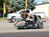 Officers from the Utah Highway Patrol speed along on their patrol bikes