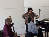 Valerie Capers plays the piano