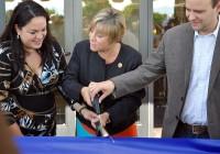 President Deneece Huftalin helps cut the ribbon