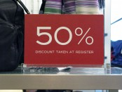 50 percent off sign in a department store