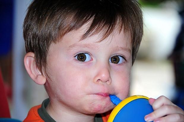 Little boy takes a sip