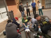 EMT students stabilize a patient