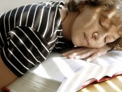 Student falls asleep on textbook