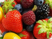 Strawberries, blackberries, blueberries and oranges