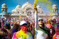 Woman throws colored chalk at the Holi Color Festival in Spanish Fork