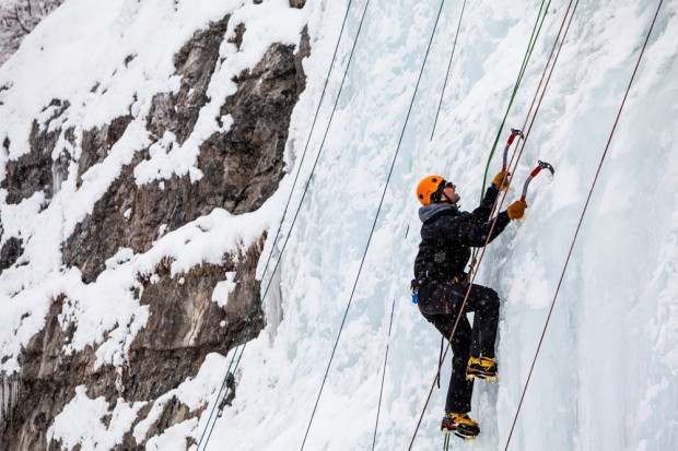 A man climbing the ice at the Bridal Veil Falls Ice Festival.
