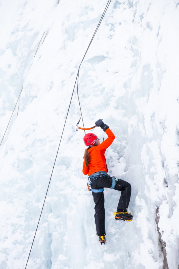 A woman ice climbing at the Bridal Veil Falls Ice Festival.