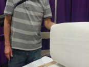 Rick Graham showing off one of his sketches at the SLCC booth at Salt Lake Comic Con 2014