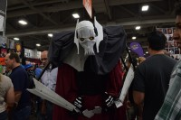 A cosplayer in the middle of a crowd dressed as General Grievous from Star Wars.