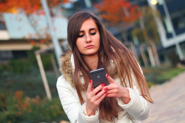 Young woman holding an iPhone