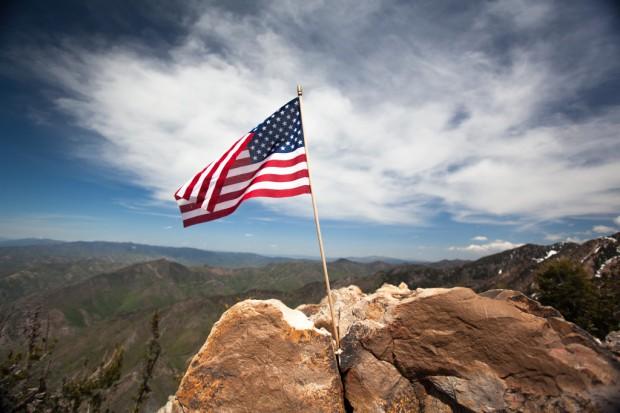 American flag flies at the top of Mt. Olympus