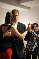 Gentlemen lead the ladies in tango dance