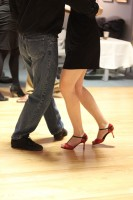 Couple's legs moving to the tango