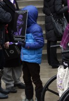Young boy holds MLK poster