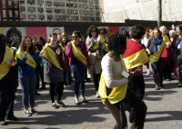 Photo of women performing an impromptu dance and drum circle outside UN headquarters