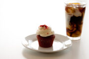 Red velvet cupcake and iced coffee.