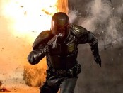 A movie still featuring Karl Urban as Judge Dredd escaping heavy fire from a gatling gun.