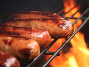 Hot dogs cooking on grill