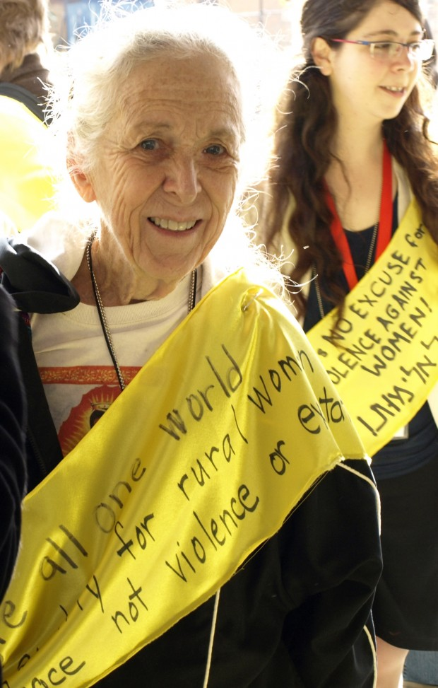 Photo of an elderly woman participating in the International Women's Day march