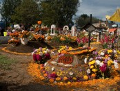 An image of a decorated grave site during Day of the Dead celebrations at the cemetery of San Antonio Tecómitl, in the Milpa Alpa borough of Mexico City, Mexico.