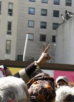 Photo of a peace sign hand gesture during International Women's Day