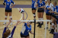 Bruin sophomore outside hitter Adria Downs (#8) attacks the ball vs. Westminster