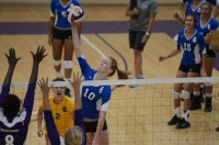 Sophomore outside hitter Bailee 'Donna' Kendall (R, #10) pounds the ball in front of fellow sophomore Indigo Allen (yellow jersey, #2) at Westminster