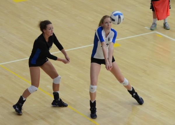 """Bailee """"Donna"""" Kendall bumps the ball as Indigo Allen provides backup."""