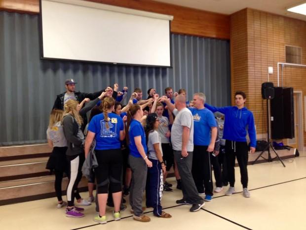 Bruin athletes huddle