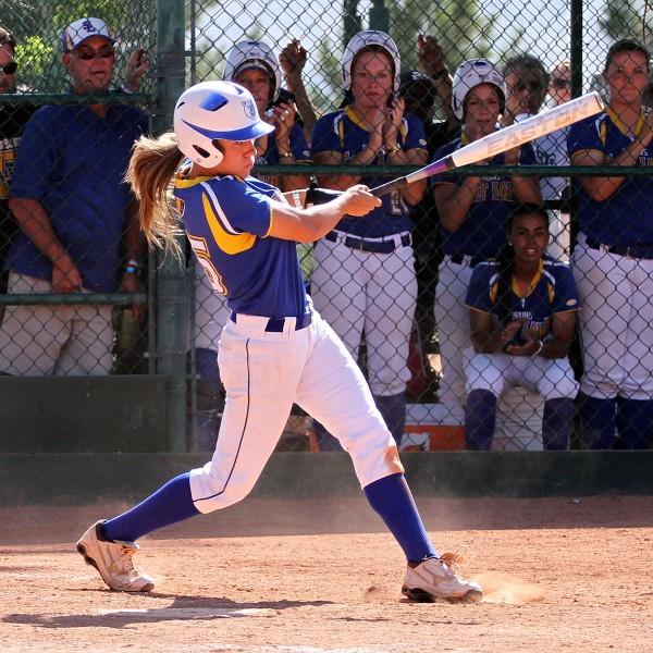 Girl hitting softball homerun