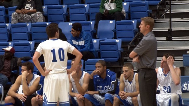 Coach Todd Phillips talks to guard Austin Waddoups