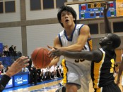 Sean Chow drives to the basket