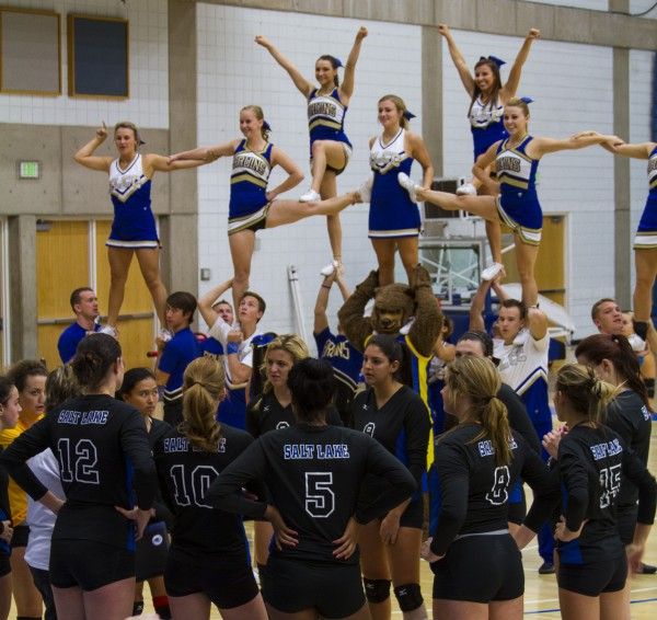 Cheer Squad in pyramid form with the help of the Bruin bear during a time out.