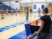 Melanie Nesbit watches volleyball practice