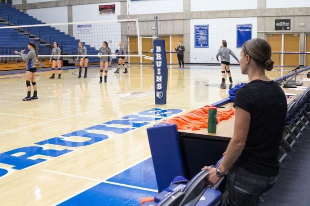 Melanie Nesbit watches volleyball practice