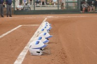 The SLCC Starters line their helmets up down the first base side as is customary prior to starting lineup introductions (vs. Chipola at Nationals).