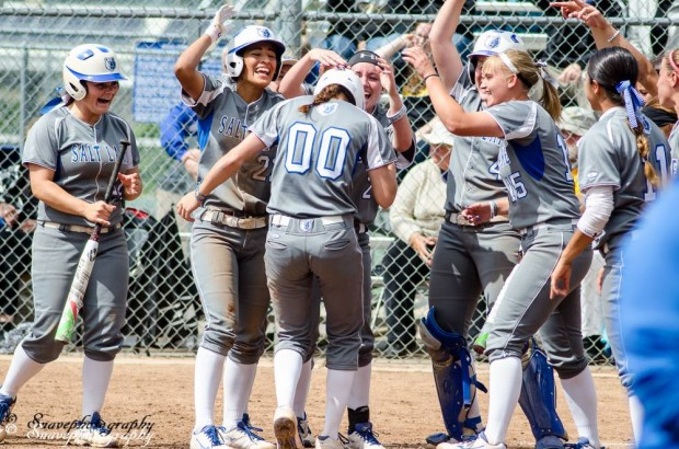 Bruins celebrate Kyrae Kogaines celebrates home run